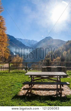 Picnic Table In Front Of A Autumnal Panorama
