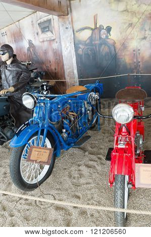 Rapaliai Lithuania - July 262015: Manor of Golden Deer are the country tourism farmstead located on picturesque historical Samogitia locality near Virvyte river in Lithuania. On the estate is situated Motorcycle Museum with current exhibits different eras