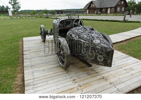 Rapaliai Lithuania - July 262015: Manor of Golden Deer are the country tourism farmstead located on picturesque historical Samogitia locality near Virvyte river in Lithuania. The location is well known for his sculptures of spare parts of automobiles.