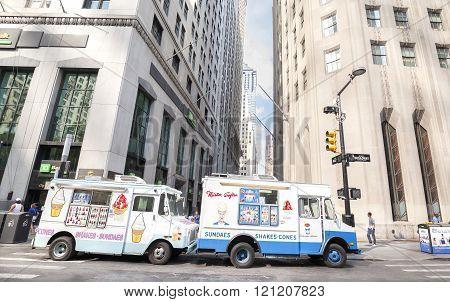 Ice Cream Trucks Delivering Sundaes.