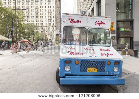 Ice cream truck parked in front of the Wall Street.