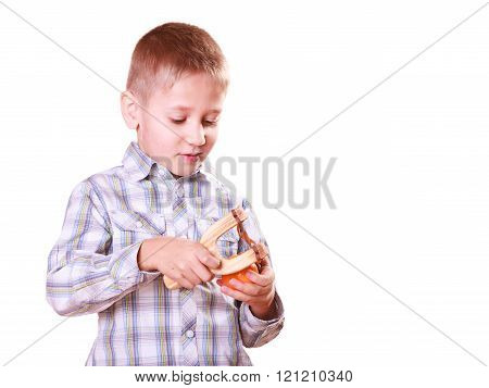 Young Boy Use Sling Shot Shoot Mandarine.