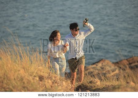 couples of younger man and woman in love relaxing vacation outdoor lifestyle