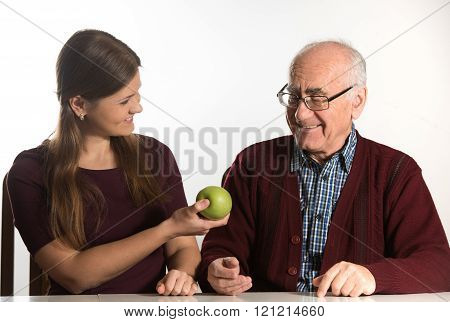 Young Woman Helps Senior Man