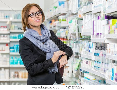 Customer Wearing Smartwatch While Looking At Products In Pharmac