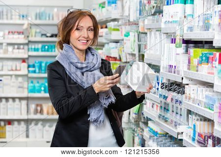 Smiling Customer Scanning Product Through Smart Phone In Pharmac