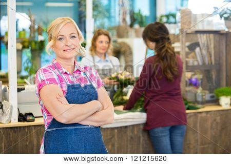 Portrait Of Confident Female Florist In Shop