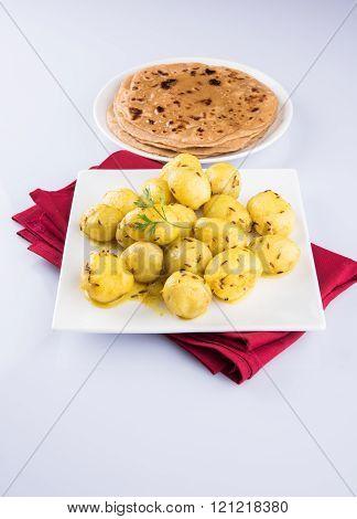 dray potato curry or potato bhaji or aalu bhaji and chapati or roti