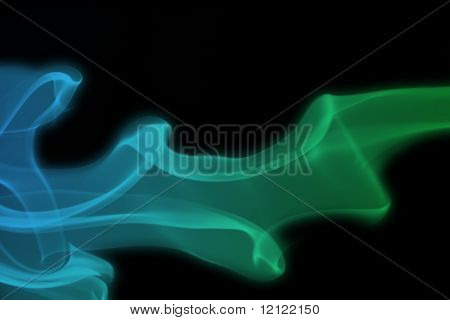 Blue and green smoke against a black background
