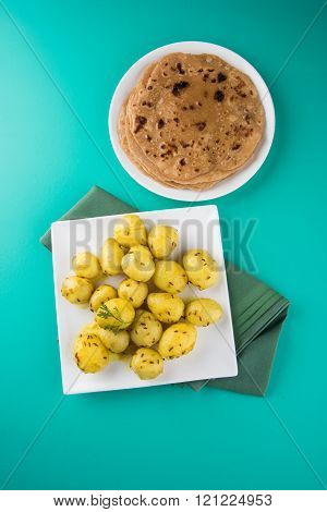 dray potato curry or potato bhaji or aalu bhaji and chapati or roti