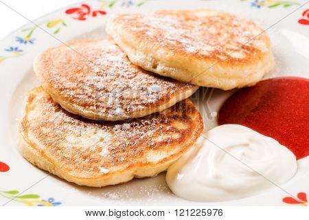 tasty pancakes with sour cream and jam