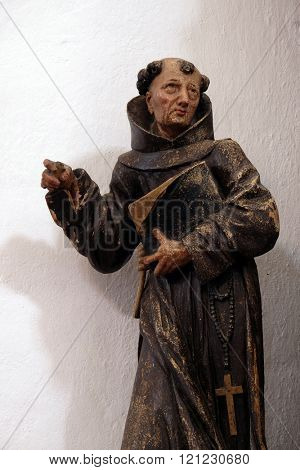 KOTARI, CROATIA - SEPTEMBER 16: Statue of Saint Bernardin on the altar of Saint Francis of Assisi in the church of Saint Leonard of Noblac in Kotari, Croatia on September 16, 2015.