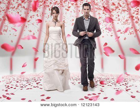 Wedding couple walking in roses