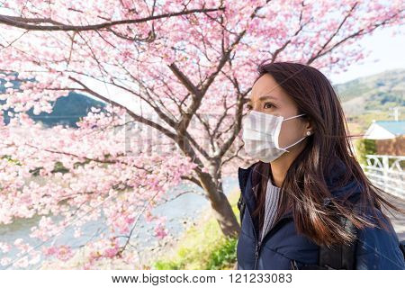 Woman wearing face mask protect from pollen allergy
