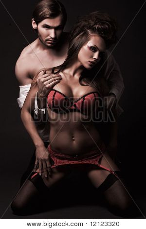 Attractive sexy couple in dark room