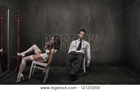 Attractive couple in a dark room