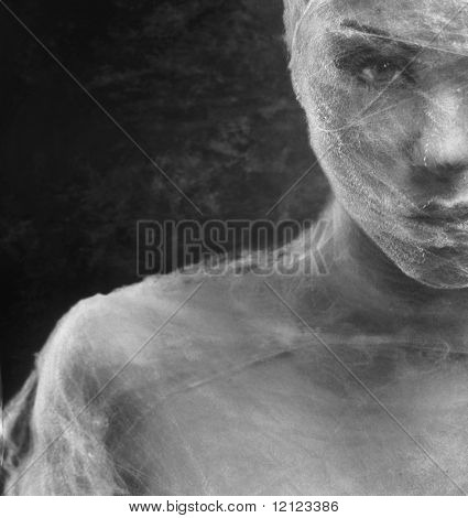Fine art photo of a young beauty's face wrapped with bandage