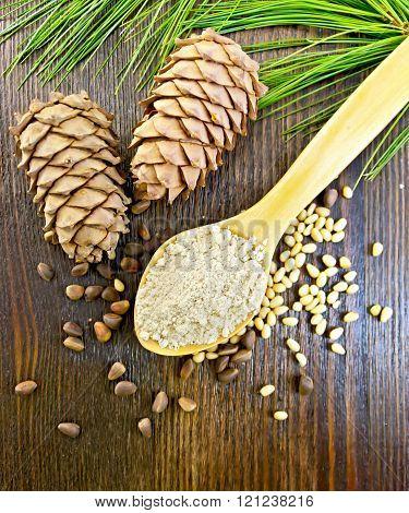 Flour cedar in spoon on board top