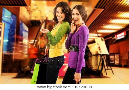 Two beautiful girls in a shopping center