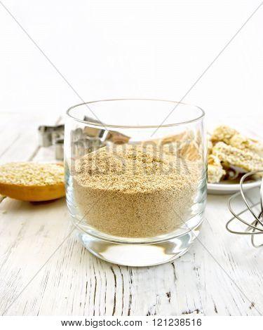 Flour sesame in glassful on board