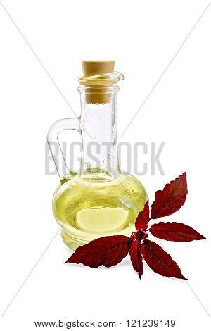 Oil with amaranth in decanter