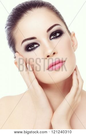 Vintage style portrait of young beautiful woman with smoky eyes make-up