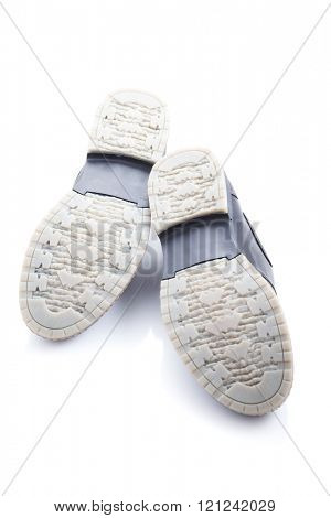 Men's shoes soles up on a white background. close-up