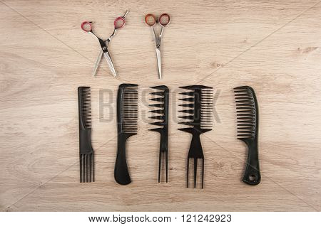 Scissors, Comb,  Hair Brushes On Table