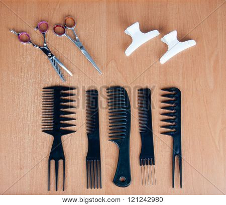 Comb Brushes, Scissors And Hairspins On The Table
