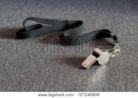 Whistle with a Black Strap
