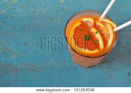 Fresh Juice Of Blood Orange, Citrus Drink On A Blue Background