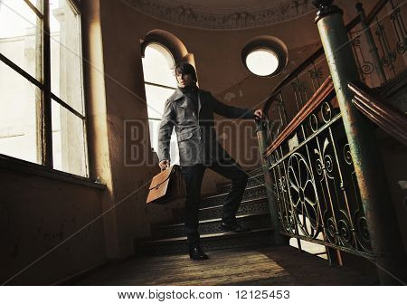 Man with a briefcase in a vintage interior