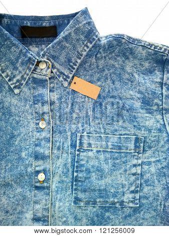 Denim shirt and tag. Blue denim shirt.
