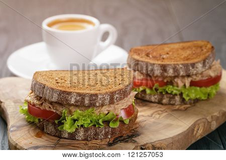 rye bread sandwich with tuna and coffee