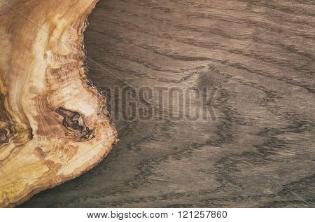 composition with olive wood board on top of oak table