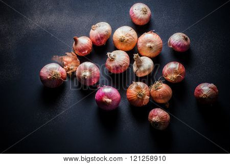 Organic Red Pearl Onions On Wooden Background
