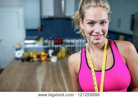 Fit woman wearing sport bra in the kitchen