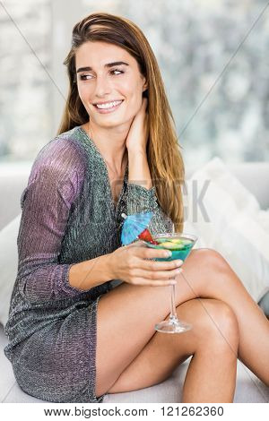 Close-up of beautiful woman smiling and having mocktail