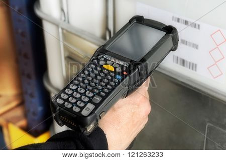 Person Scanning A Barcode With A Scanner