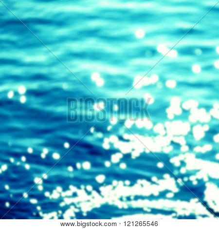 Summer Background / Sparkles over blue water. / Poster on tropical beach background with sparkling