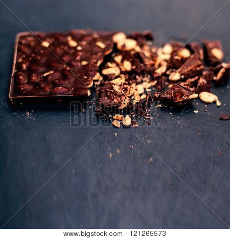 Chocolate / Nut Chocolate bar / chocolate background / Crushed Broken Dark Chocolate