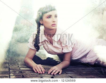 Romantic style portrait of a young brunette beauty