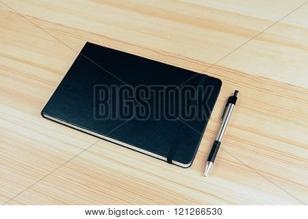 Blank Cover Of Notebook With Pen On Wooden Table, Mock Up