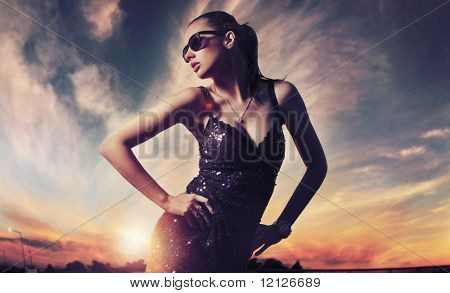 Perfect fashionable lady wearing sunglasses