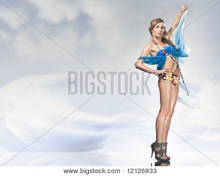 Stunning blonde posing over sky background