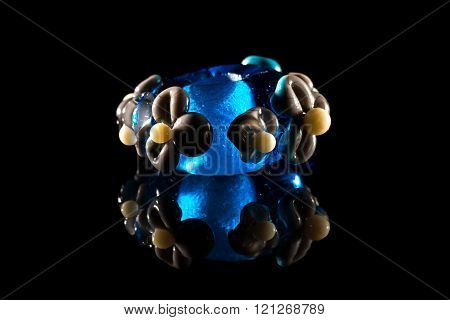 Transparent blue and brown glassy bead