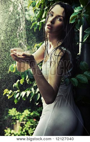 Young woman in a rain forest