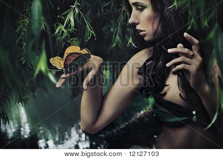 Portrait of a beauty brunette with butterfly