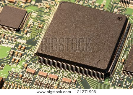 Macro of a tiny but powerful microchip mounted on a circuit board