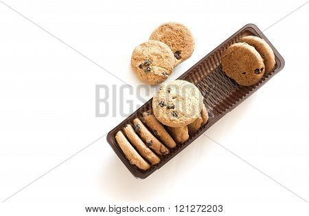 a few cookies with raisins in packaging